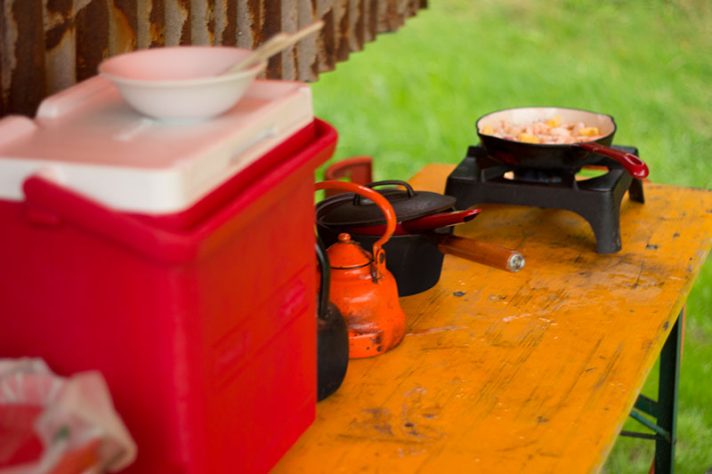 Field kitchen with stove and cool box