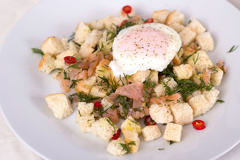 Brunch smoked salmon panzanella with poached egg