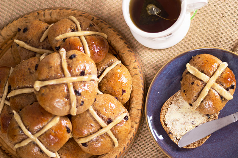 These spiced spelt hot cross buns make perfect Easter treats, being beautifully flavoured with allspice and cinnamon plus orange zest and mixed fruit with a marmalade glaze. Its also a reduced sugar recipe and wheat free, using wholesome spelt flour instead or traditional wheat and can be made with goat milk and butter.