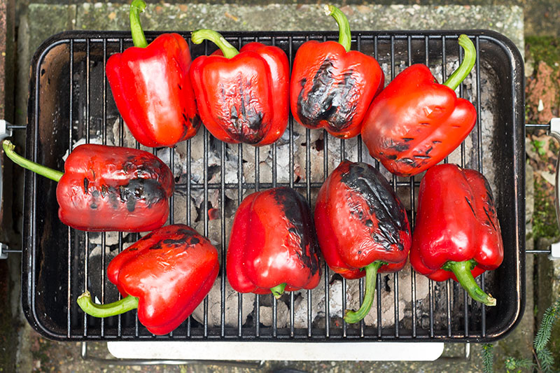 Charred red peppers on BBQ
