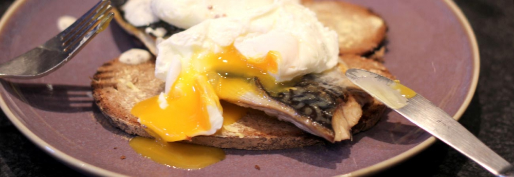 mackerel on rye bread with poached eggs and mustard yoghurt sauce