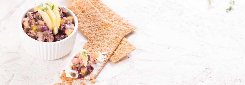 Preserved lemon tapenade on a cracker and in a bowl