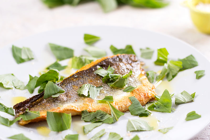 Quick sea bass with torn basil and smoked salt
