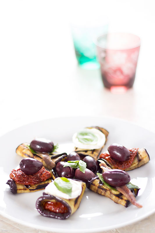 Chargrilled aubergine rolls on plate