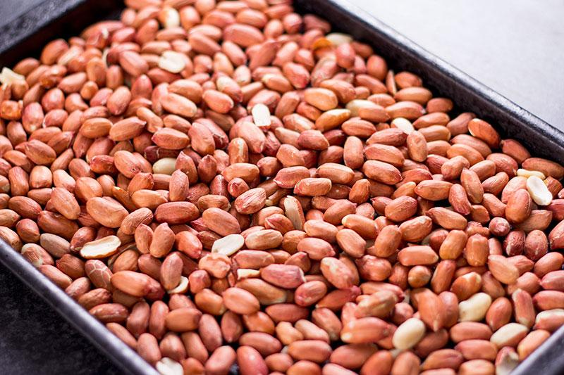A tray of raw peanuts