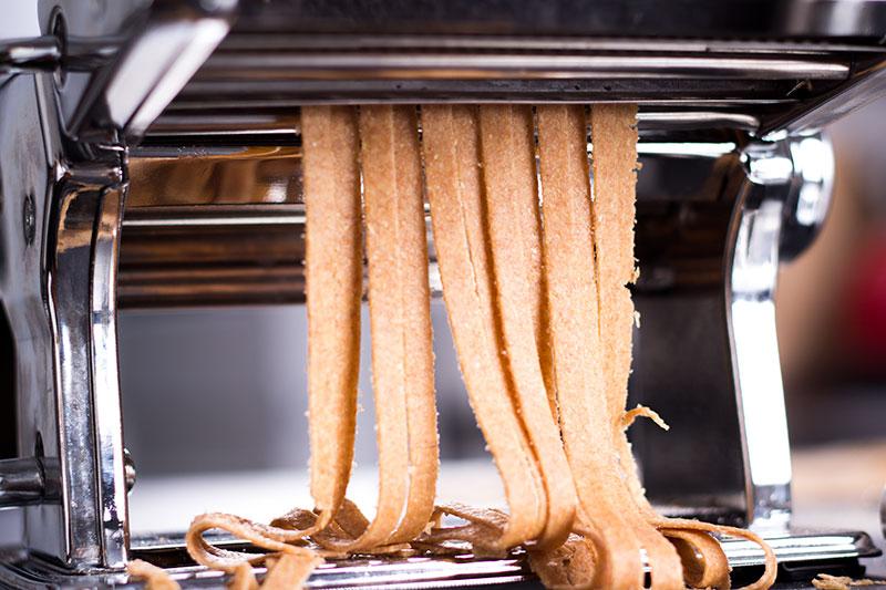 wholemeal spelt pasta tagliatelle being cut