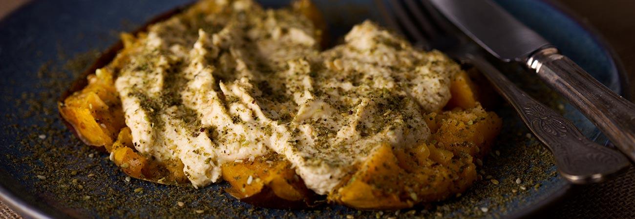 baked sweet potato with humous and za'atar