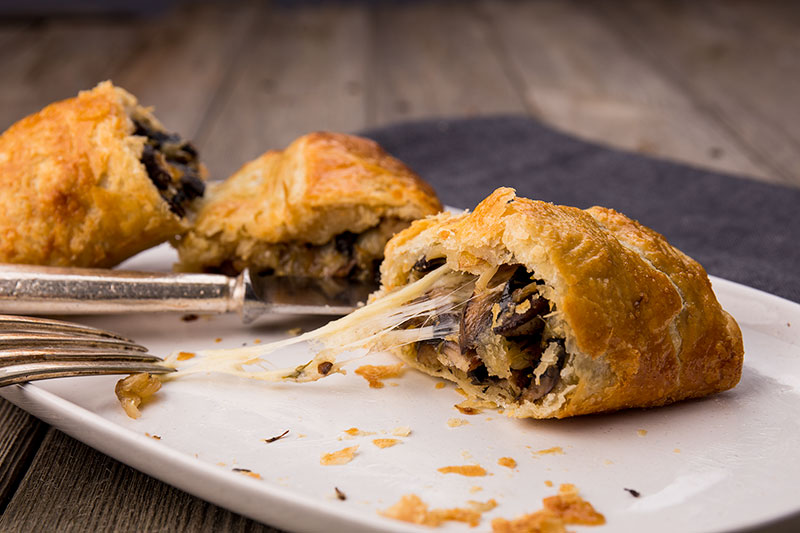 Golden, light and flaky vegetarian sausage rolls made with spelt rough puff pastry and filled with onion, garlic, mushrooms, thyme and oozing, molten Comté cheese. Perfect for the dinner table or the picnic basket.