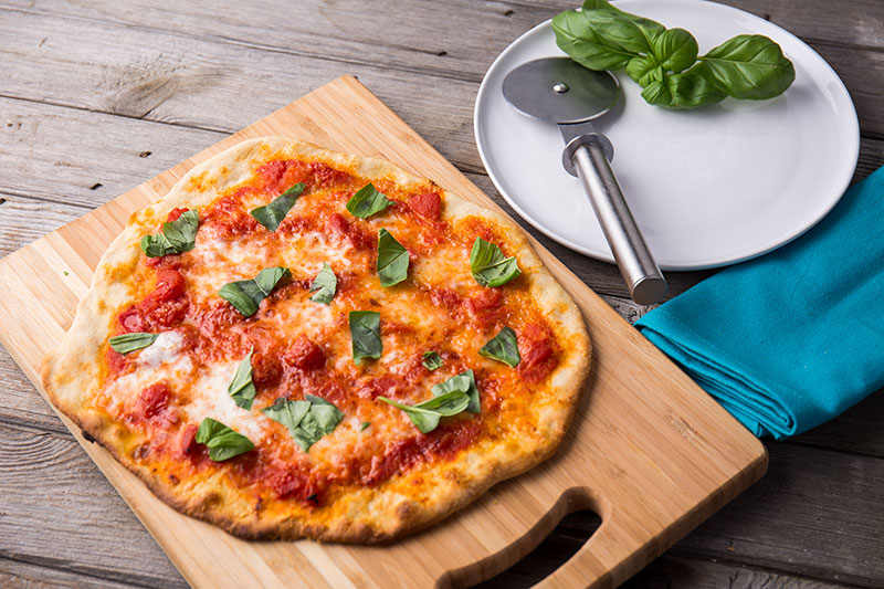 Perfect spelt pizza bases made with spelt flour to create crispy, thin crust, beautiful homemade pizzas that any Italian would be proud of to top how you like or enjoy the beauty of a margherita, perfect for the summer weather and a meal that everyone can get involved in.