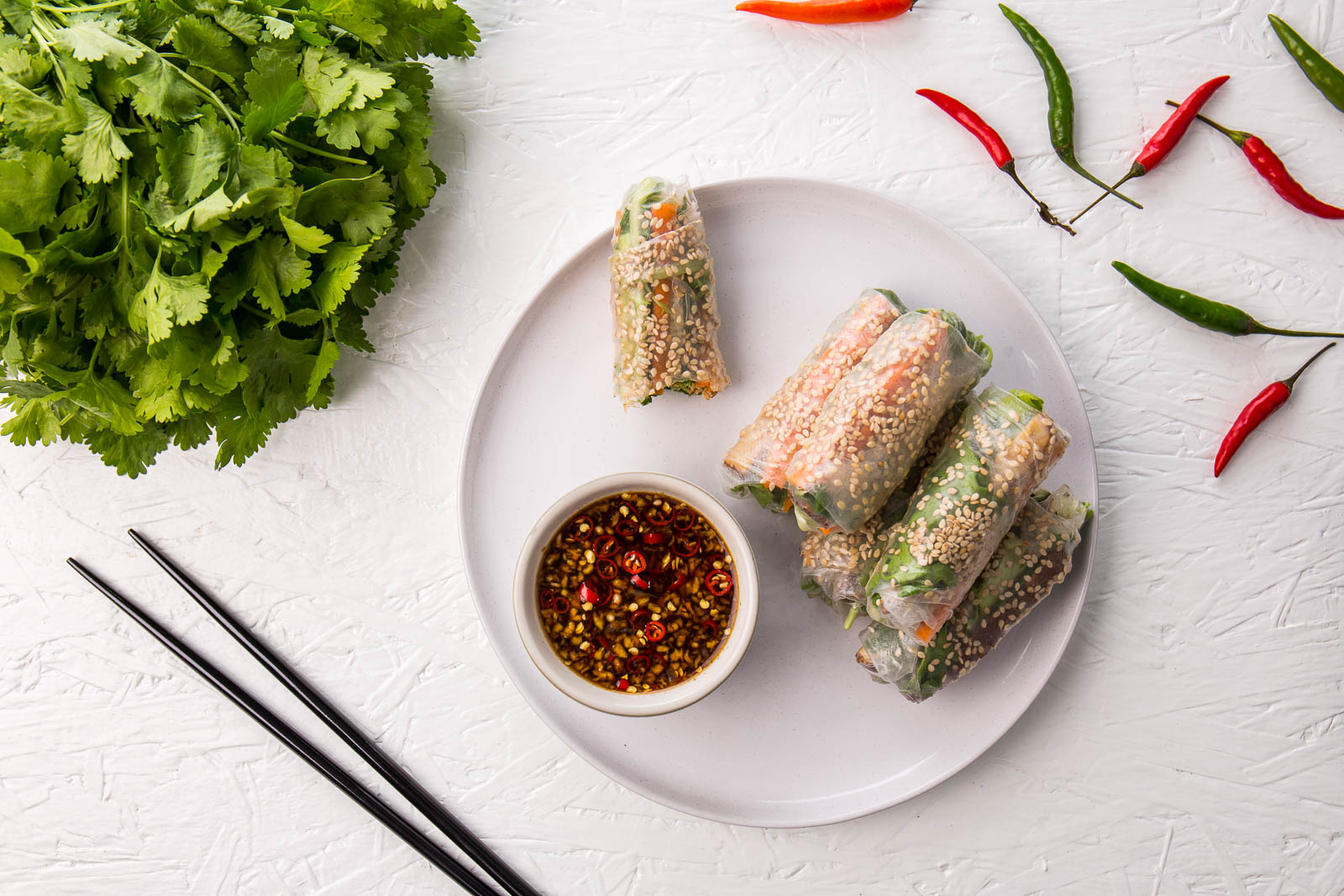 Vietnamese spring rolls with a vegetarian twist, featuring smoked tofu to make delightfully aromatic, crispy, crunchy tofu summer rolls which are vegetarian and vegan. You can make these in the kitchen to wow your guests or build them at the table so everyone can get their hands dirty.
