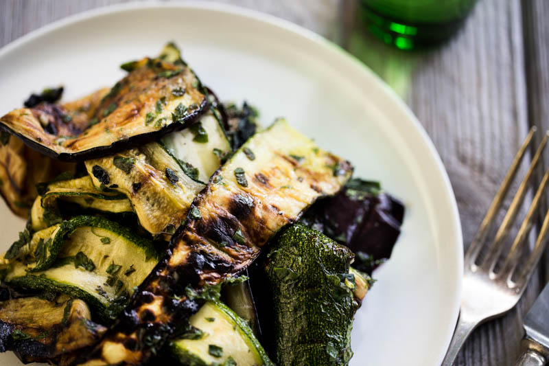 Courgette and aubergine antipasti is a simple vegan and vegetarian summer BBQ recipe perfect for lunches or picnics. Grilled or BBQ vegetables mixed with a simple dressing of olive oil, garlic, mint and white wine vinegar make a perfect make ahead side salad that tastes better after 24 hours in the fridge! Make the most of the summer's abundant courgettes and aubergines with this amazingly tasty Italian side dish!