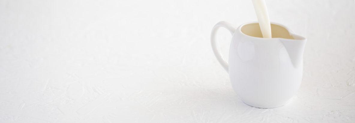 Lactose intolerant Milk pouring into jug