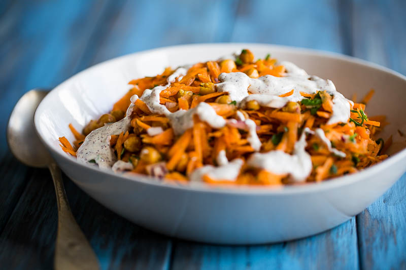 A quick, versatile and tasty vegetarian carrot and chickpea salad that you can add your own ingredients to for if you want to experiment. Made with carrots, chickpeas and parsley, it's a simple base that gets flavoured up with sumac, yoghurt, lemon juice and tahini so that there's no chance of your taste buds left wanting. It makes a great side dish or just fill your bowl and have it as a main course!