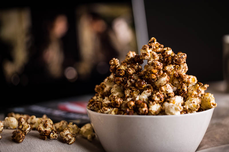Sweet cinnamon popcorn made on the stove in a saucepan is great fun as you watch all the kernels fly all over the place! Made with low sugar content and ready in minutes, you'll wonder why you ever bought pre-made popcorn!
