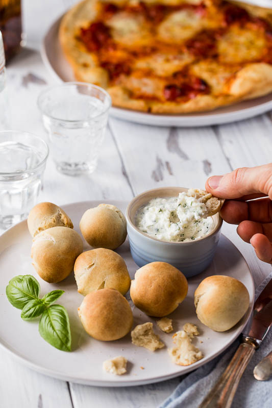 Hot, crunchy, soft, doughy balls of deliciousness, cooked in the oven alongside a perfect homemade spelt pizza. Dipping duties are handed over to a simple thick and creamy garlic coconut butter dip all ready to plunge these spelt dough balls into as soon as they're out of the oven.