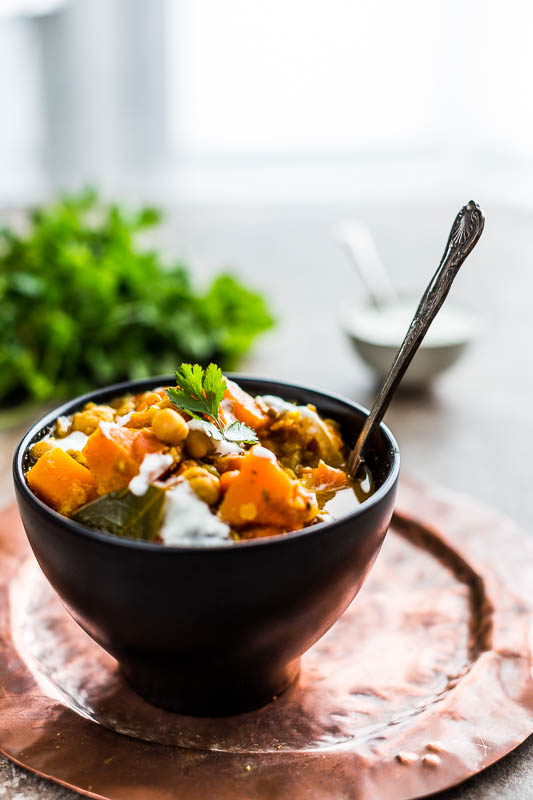 A filling and sustaining chunky soup loaded with goodness and hearty ingredients. This chunky butternut squash and lentil soup is a meal-in-a-bowl which virtually becomes a stew as the liquid is almost entirely soaked up by the lentils, chickpeas and squash. The Indian influenced spices have come in to play, featuring a warming host of flavours which will warm your cockles even when the temperature's so cold that the central heating doesn't. It's so good that it's my lunch bowl for the next three weeks, yes, I've just made a triple batch of this, giving me a happy fridge and freezer full of lunchtime joy.