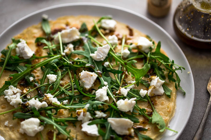 Whether it's shrove tuesday or any other tuesday, you can always eat pancakes! Topped with crumbled goat's cheese, rocket and a rich, sweet pomegranate olive oil dressing, these savoury pancakes need very little prep so make an easy dinner. You can use the maple syrup on the next one!
