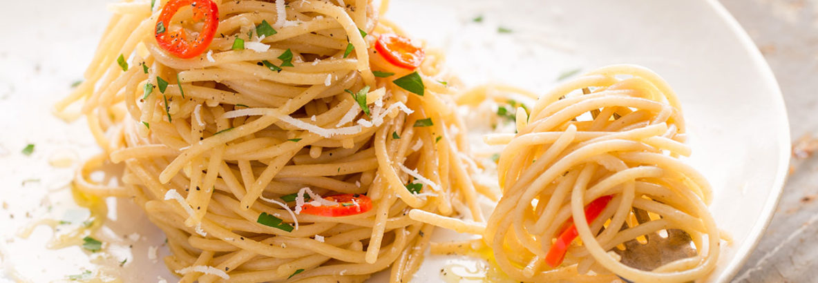 Traditional Italian pasta dish, aglio olio con peperoncino translates as garlic, oil and chilli in English, a trio of simple flavours which make a truly epic dish, full of elegant beauty. Gently infused garlic works it's way into the olive oil, which is rounded off with a kick of chilli and a hint of parsley, topped with a good dousing of pecorino or parmesan cheese. It's a truly authentic yet quick pasta dish, which is a real treat to eat.