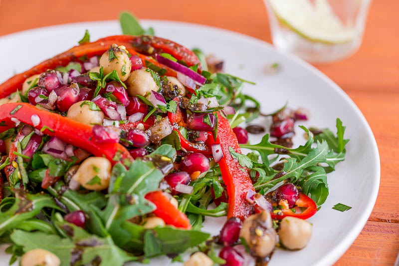 Sweet, crunchy pomegranate seeds sit alongside the sweet, sharp pomegranate molasses in this light chickpea and red pepper salad which makes a great side dish, accompaniment to bread & cheese or alongside a bigger meal or picnic. It really is simple, with no cooking and just a few ingredients, most of which can be kept in the cupboard to whip together at the last second. It's vegetarian and vegan as well, so perfect or everyone!