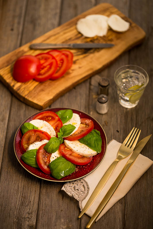 Traditional Caprese salad doesn't have pesto, balsamic, loads of herbs or other ingredients, it's just fantastic tomatoes, mozzarella di bufala campana, basil, extra virgin olive oil and salt and pepper. That is all you need for the most amazing, light, bright, fresh mouthful of summer. When you see the tomatoes in season, it's time to jump at this perfect vegetarian lunch dish and KISS! (Keep It Simple, Stupid!)