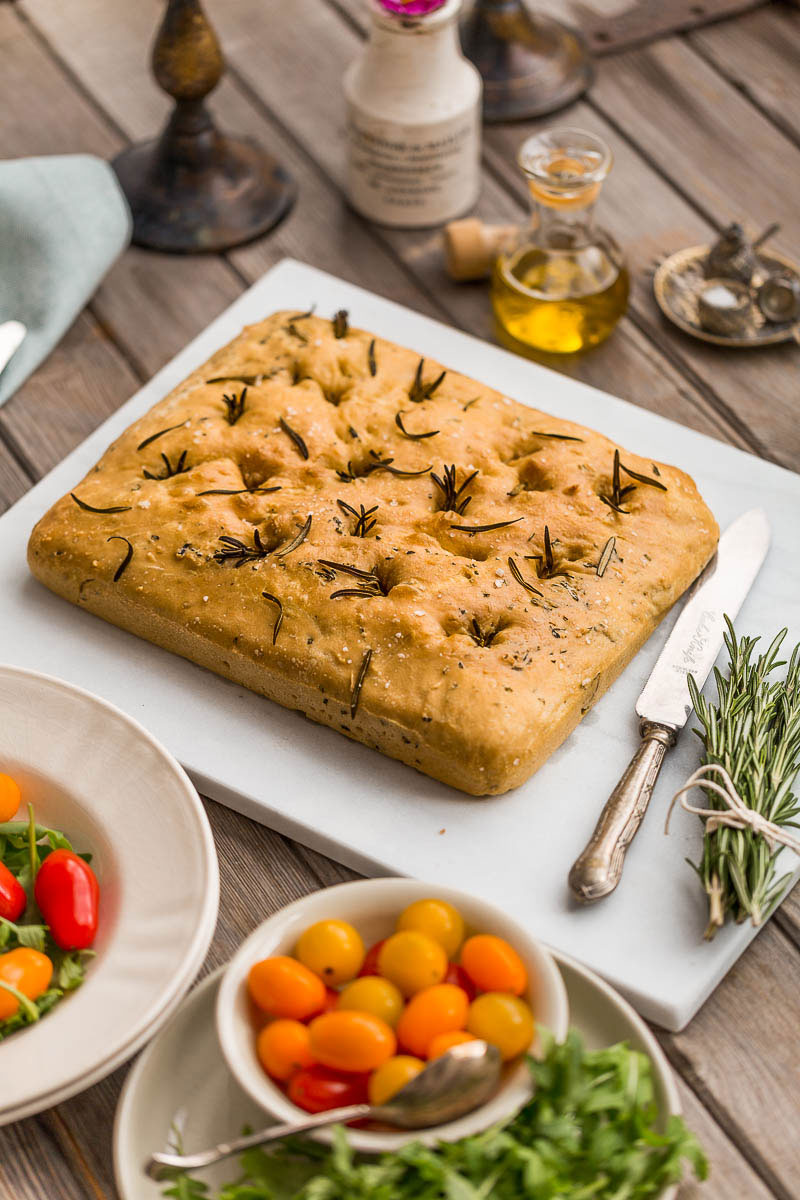 Tender, fresh, homemade Italian spelt focaccia, studded with rosemary sprigs and drizzled with olive oil. The job of baking bread at home may seem like an onerous task, but when it produces such beautifully tender, flavoursome bread, the ability to bake your own bread begins to feel more like a special privilege.