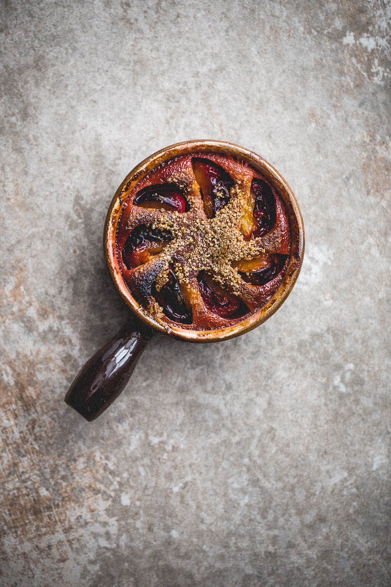 Seasonal plums cooked in batter and topped with demerara sugar heated under the grill to give a crispy, crunchy lid. This dessert is simple, opulent and as romantic as the French name implies. Perfect make-ahead dessert for guests.