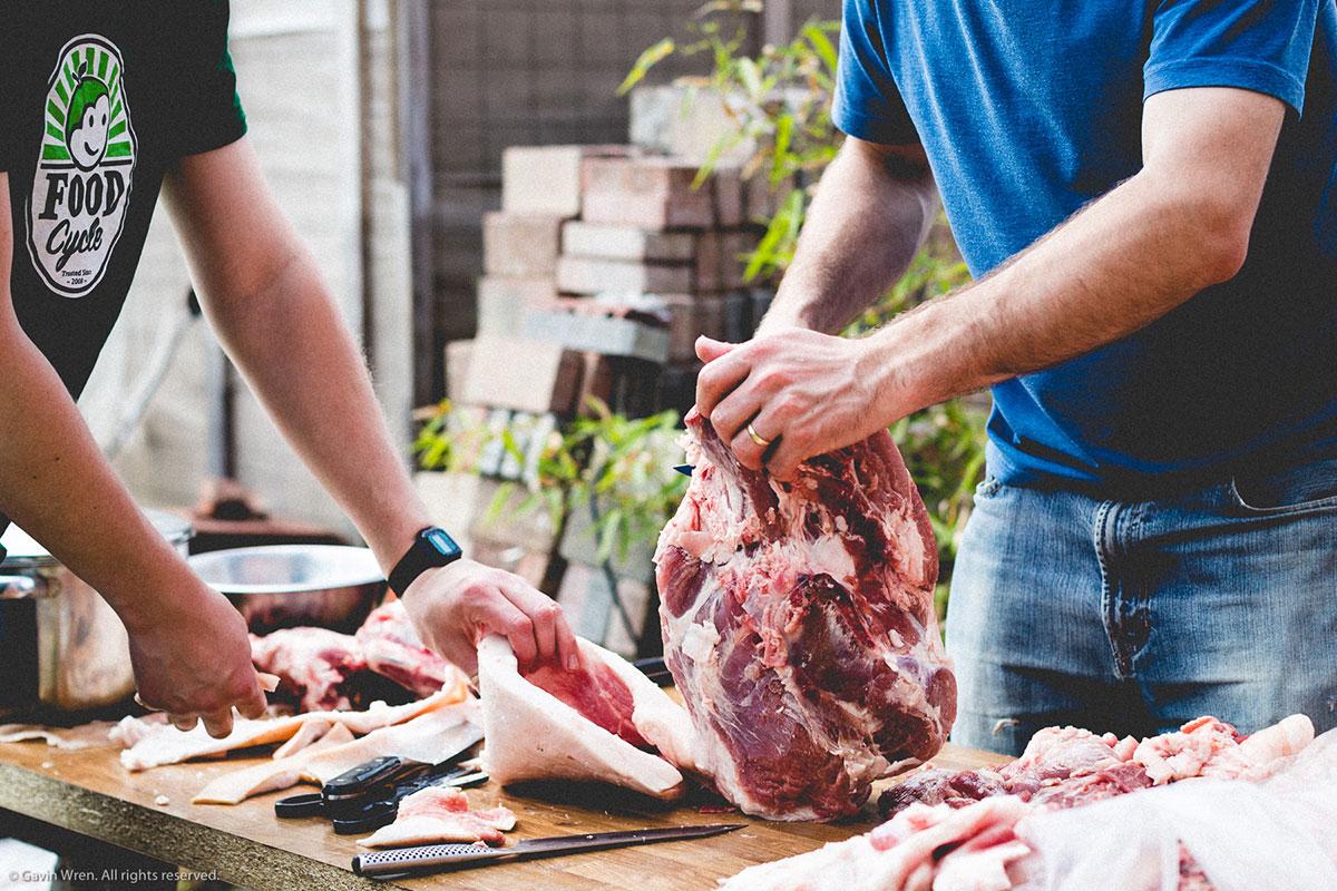 eating meat preparing a pig